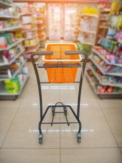 basket on shopping cart in supermarket